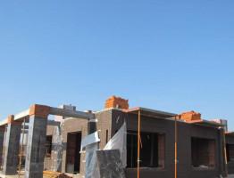 Коттедж Акманай с отштукатуренным фасадом